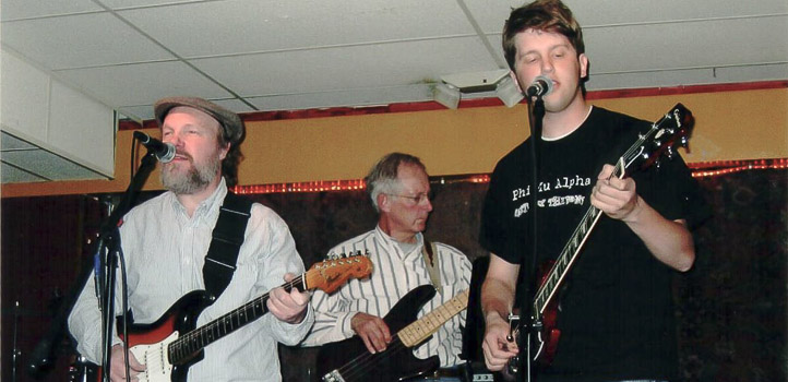 From right, students Rich Gilbaugh and Dick Ahrens, performing with John at the Mill Student Recital, circa 2005